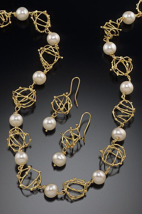 open woven pearl necklace and earrings